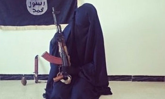 Zahra Halane, 16, poses with an AK-47, an Isis flag, knife and grenade. A series of tweets about her kitten, thrown out by her husband, betray her youth.